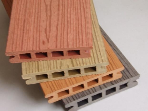 examples of wood plastic lumber. They are made to slot together and after installation can often be indiscernible from real wood boards.